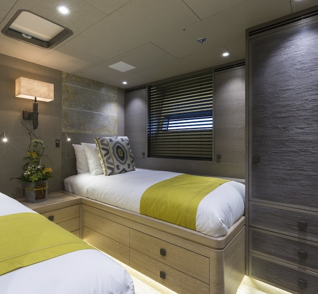 Guest Cabin super yacht Inukshuk, hand painted bed heads & wall sconces by Hannah Woodhouse